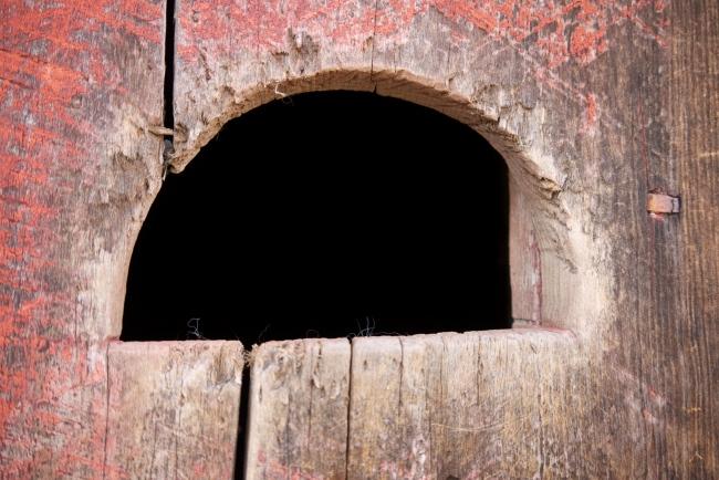 hand hole in barn door