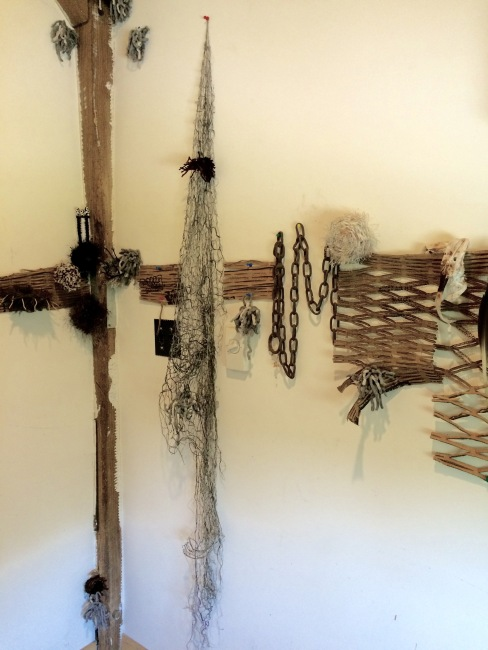 detail of installation, mixed media including yarn, wire, cardboard, plastic netting and steel chain.